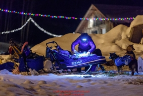 Travis Beals packs his sled by headlamp as he prepares to leave the Takotna checkpoint during his 24-hour layover on Thursday, March 8th during the 2018 Iditarod Sled Dog Race -- AlaskaPhoto by Jeff Schultz/SchultzPhoto.com  (C) 2018  ALL RIGHTS RESERVED