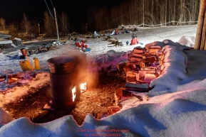 Dog water stays hot in barrels as mushers prepare to leave the Takotna checkpoint after their 24-hour layover on Thursday, March 8th during the 2018 Iditarod Sled Dog Race -- AlaskaPhoto by Jeff Schultz/SchultzPhoto.com  (C) 2018  ALL RIGHTS RESERVED