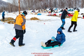 On a traveling vaction on the Iditarod Wooden Saunders and daughter sled down a hill at the Takotna checkpoint on Thursday, March 8th during the 2018 Iditarod Sled Dog Race -- AlaskaPhoto by Jeff Schultz/SchultzPhoto.com  (C) 2018  ALL RIGHTS RESERVED