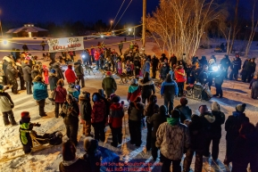 Mitch Seavey is surrounded by villagers as he arrived in first place and wins the GCI Dorothy G. Page Halfway award at the Huslia checkpoint during the 2017 Iditarod on Thursday night  March 9, 2017.Photo by Jeff Schultz/SchultzPhoto.com  (C) 2017  ALL RIGHTS RESERVED