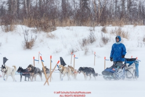 Noah Pereira on the trail heading into the Iditarod checkpoint as the wind blows snow on Friday, March 9th during the 2018 Iditarod Sled Dog Race -- AlaskaPhoto by Jeff Schultz/SchultzPhoto.com  (C) 2018  ALL RIGHTS RESERVED