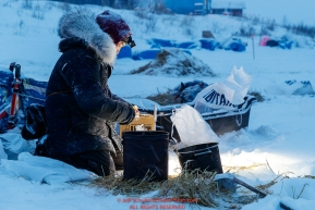 Mike Williams Jr. melts snow for his dog water during a snowfall at the Iditarod checkpoint in the morning on Friday, March 9th during the 2018 Iditarod Sled Dog Race -- AlaskaPhoto by Jeff Schultz/SchultzPhoto.com  (C) 2018  ALL RIGHTS RESERVED