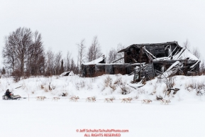 Jim Lanier passes a derelict cabin on the trail into the Iditarod checkpoint on Friday, March 9th during the 2018 Iditarod Sled Dog Race -- AlaskaPhoto by Jeff Schultz/SchultzPhoto.com  (C) 2018  ALL RIGHTS RESERVED