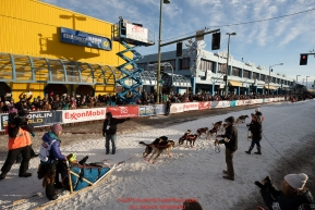 Shaynee Traska leaves the 4th avenue start line during the ceremonial start of the 2019 Iditarod in downtown Anchorage, Alaska on Saturday March 2.Photo by Jeff Schultz/  (C) 2019  ALL RIGHTS RESERVED