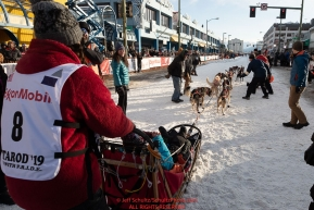 Kristin Bacon leaves the start line during the ceremonial start of the 2019 Iditarod in downtown Anchorage, Alaska on Saturday March 2.Photo by Jeff Schultz/  (C) 2019  ALL RIGHTS RESERVED