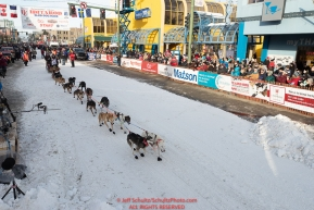 Anna Berington leaves the start line on 4th avenue during the ceremonial start of the 2019 Iditarod in downtown Anchorage, Alaska on Saturday March 2.Photo by Jeff Schultz/  (C) 2019  ALL RIGHTS RESERVED