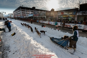 Lev Shvarts leaves the 4th avenue start line during the ceremonial start of the 2019 Iditarod in downtown Anchorage, Alaska on Saturday March 2.Photo by Jeff Schultz/  (C) 2019  ALL RIGHTS RESERVED
