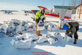 Longtime trail volunteers John Hooley and Randy Johnson sort through musher return bags at the Galena airport during the 2017 Iditarod on Friday afternoon March 10, 2017.Photo by Jeff Schultz/SchultzPhoto.com  (C) 2017  ALL RIGHTS RESERVED