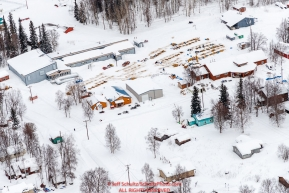 Teams rest on straw around the village of Grayling community center checkpoint on the Yukon River on Saturday, March 10th during the 2018 Iditarod Sled Dog Race -- AlaskaPhoto by Jeff Schultz/SchultzPhoto.com  (C) 2018  ALL RIGHTS RESERVED