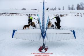 Dropped dogs wait to be loaded into Jerry Wortley's plane at the ghost-town checkpoint of Iditarod on Saturday, March 10th during the 2018 Iditarod Sled Dog Race -- AlaskaPhoto by Jeff Schultz/SchultzPhoto.com  (C) 2018  ALL RIGHTS RESERVED