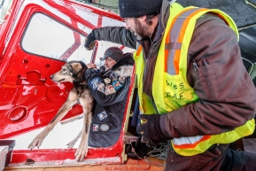 Veterinarian Mike Walker loads a dropped dog to pilot Wes Erb at the ghost-town checkpoint of Iditarod on Saturday, March 10th during the 2018 Iditarod Sled Dog Race -- AlaskaPhoto by Jeff Schultz/SchultzPhoto.com  (C) 2018  ALL RIGHTS RESERVED
