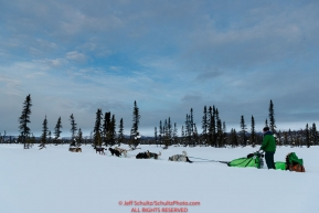 Ryan Redington runs on the trail shorlty after leaving the Kaltag checkpoint on Sunday morning March 10th during the 2019 Iditarod Trail Sled Dog Race.Photo by Jeff Schultz/  (C) 2019  ALL RIGHTS RESERVED