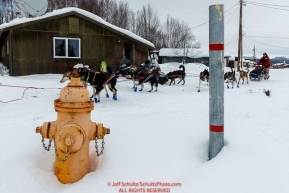 Ramey Smyth and team run past a fire hydrant as he leaves the Kaltag checkpoint on Sunday morning March 10th during the 2019 Iditarod Trail Sled Dog Race.Photo by Jeff Schultz/  (C) 2019  ALL RIGHTS RESERVED