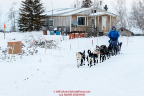 Ketil Reitan runs down the road and past encouraging signs on the trail out of  the Huslia checkpoint during the 2017 Iditarod on Saturday morning March 11, 2017.Photo by Jeff Schultz/SchultzPhoto.com  (C) 2017  ALL RIGHTS RESERVED