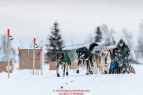 Jeff King and team run down the bank and onto the Koyukuk River as they leave the Huslia checkpoint during the 2017 Iditarod on Saturday morning March 11, 2017.Photo by Jeff Schultz/SchultzPhoto.com  (C) 2017  ALL RIGHTS RESERVED