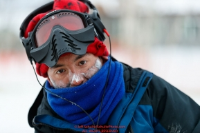 Ryan Redington keeps his frost-nipped face covered at the Huslia checkpoint during the 2017 Iditarod on Saturday morning March 11, 2017.Photo by Jeff Schultz/SchultzPhoto.com  (C) 2017  ALL RIGHTS RESERVED