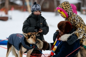 Local school children pet a Ryan Redington dog
