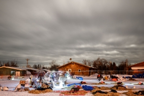 Dogs rest as musher and veterinarian headlamps make streaks in this time-exposure as the full moon pushes behind clouds at the Huslia checkpoint during the 2017 Iditarod on Saturday morning March 11, 2017.Photo by Jeff Schultz/SchultzPhoto.com  (C) 2017  ALL RIGHTS RESERVED