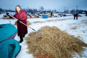 Huslia resident Margie Ambrose volunteers to clean up straw at the Huslia checkpoint during the 2017 Iditarod on Saturday morning March 11, 2017.Photo by Jeff Schultz/SchultzPhoto.com  (C) 2017  ALL RIGHTS RESERVED