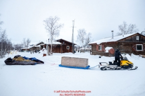 A local resident runs a pile of used dog straw to the dump at the Huslia checkpoint during the 2017 Iditarod on Saturday morning March 11, 2017.Photo by Jeff Schultz/SchultzPhoto.com  (C) 2017  ALL RIGHTS RESERVED