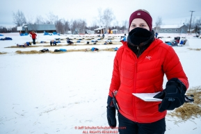 Volunteer Comms, Holly Bennett, is out gathering the latest information on in/out times to relay back to Iditarod HQ at the Huslia checkpoint during the 2017 Iditarod on Saturday morning March 11, 2017.Photo by Jeff Schultz/SchultzPhoto.com  (C) 2017  ALL RIGHTS RESERVED