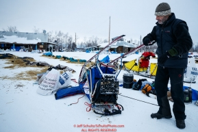 French musher Nicolas Vanier works on his sled at the Huslia checkpoint during the 2017 Iditarod on Saturday morning March 11, 2017.Photo by Jeff Schultz/SchultzPhoto.com  (C) 2017  ALL RIGHTS RESERVED
