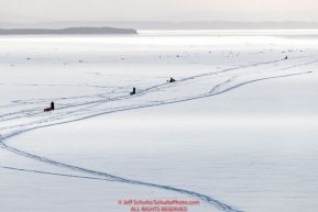 Four dog teams travel up the Yukon River on the way into the Kaltag village checkpoint on Sunday afternoon March 11th during the 2018 Iditarod Sled Dog Race -- AlaskaPhoto by Jeff Schultz/SchultzPhoto.com  (C) 2018  ALL RIGHTS RESERVED