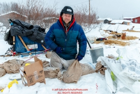 Ramey Smyth goes through his drop bags at the Kaltag village checkpoint on Sunday morning March 11th during the 2018 Iditarod Sled Dog Race -- AlaskaPhoto by Jeff Schultz/SchultzPhoto.com  (C) 2018  ALL RIGHTS RESERVED