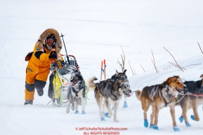 Michi Konno runs up the bank of the Yukon River and into  the Kaltag village checkpoint on Sunday morning March 11th during the 2018 Iditarod Sled Dog Race -- AlaskaPhoto by Jeff Schultz/SchultzPhoto.com  (C) 2018  ALL RIGHTS RESERVED