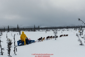 Sarah Stokey runs on the trail at the Tripod Flats cabin on the run from Kaltag to the Unalakleet checkpoint on Monday afternoon March 11th during the 2019 Iditarod Trail Sled Dog Race.Photo by Jeff Schultz/  (C) 2019  ALL RIGHTS RESERVED
