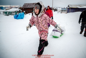 12-year old Jamie McGinty volunteers to haul John Baker's drop bags to his team at the Kaltag checkpoint during the 2017 Iditarod on Sunday morning March 12, 2017.Photo by Jeff Schultz/SchultzPhoto.com  (C) 2017  ALL RIGHTS RESERVED