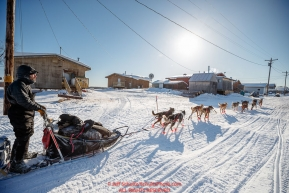 Sebastien Vergnaud runs down the road of the village as he arrives at the Kaltag checkpoint during the 2017 Iditarod on Sunday afternoon March 12, 2017.Photo by Jeff Schultz/SchultzPhoto.com  (C) 2017  ALL RIGHTS RESERVED