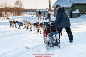 Noah Burmeister works his sled as he rounds a corner on the road leavng the Kaltag checkpoint during the 2017 Iditarod on Sunday evening  March 12, 2017.Photo by Jeff Schultz/SchultzPhoto.com  (C) 2017  ALL RIGHTS RESERVED