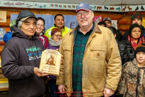 Richard Burnham, on behalf of the entire family accepts the Herbie Nayokupuk Spirit of Iditarod for his father-in-law Austin Esmailka, from race judge Kevin Sakai at the Kaltag checkpoint during the 2017 Iditarod on Sunday morning March 12, 2017.Photo by Jeff Schultz/SchultzPhoto.com  (C) 2017  ALL RIGHTS RESERVED