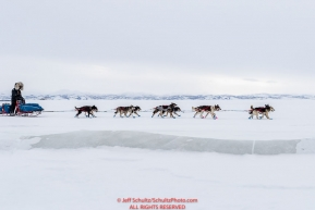 Mike Williams Jr. on the slough ice on the trail nearing the Unalakleet checkpoint on Monday  afternoon March 12th during the 2018 Iditarod Sled Dog Race -- AlaskaPhoto by Jeff Schultz/SchultzPhoto.com  (C) 2018  ALL RIGHTS RESERVED