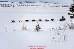 Charley Bejna runs on the slough as he arrives at the Unalakleet checkpoint on Monday  afternoon March 12th during the 2018 Iditarod Sled Dog Race -- AlaskaPhoto by Jeff Schultz/SchultzPhoto.com  (C) 2018  ALL RIGHTS RESERVED