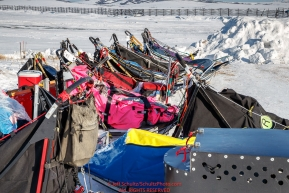 Replacement sleds sit waiting for their mushers at the Unalakleet checkpoint during the 2017 Iditarod on Monday afternoon  March 12, 2017.Photo by Jeff Schultz/SchultzPhoto.com  (C) 2017  ALL RIGHTS RESERVED