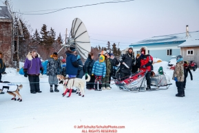 A small crowd gathers around Aliy Zirkle as she checks in to the Koyuk checkpoint during the 2017 Iditarod on Monday evening at sunset  March 12, 2017.Photo by Jeff Schultz/SchultzPhoto.com  (C) 2017  ALL RIGHTS RESERVED