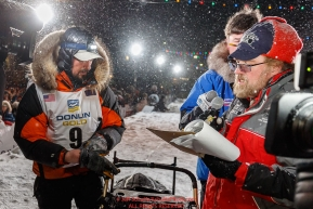 Pete Kaiser signs in at the Nome finish line to win the 2019 Iditarod Trail Sled Dog Race. Pete's winning time is 9 days 12 hours 39 minutes and 6 secondsPhoto by Jeff Schultz/  (C) 2019  ALL RIGHTS RESERVED