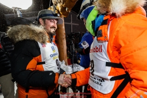 First place winner Pete Kaiser congratulates second place finisher Joar Leifseth Ulsom at the Nome finish line shortly after winning the 2019 Iditarod Trail Sled Dog Race. Pete's winning time is 9 days 12 hours 39 minutes and 6 secondsPhoto by Jeff Schultz/  (C) 2019  ALL RIGHTS RESERVED