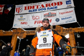Pete Kaiser stands at his sled at the Nome finish line shortly after winning the 2019 Iditarod Trail Sled Dog Race. Pete's winning time is 9 days 12 hours 39 minutes and 6 secondsPhoto by Jeff Schultz/  (C) 2019  ALL RIGHTS RESERVED