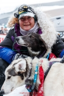Jessie Royer is all smiles as she congratulates her lead dogs Seal and Striker shortly after crossing the finish line in Nome to place 3rd in the 2019 Iditarod sled dog race.Photo by Jeff Schultz/  (C) 2019  ALL RIGHTS RESERVED