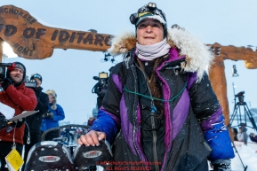 Jessie Royer poses at the Nome finish line shortly after placing 3rd in the 2019 Iditarod sled dog race.Photo by Jeff Schultz/  (C) 2019  ALL RIGHTS RESERVED