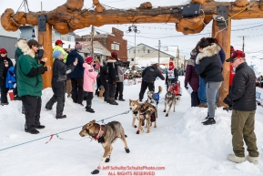 Aliy Zirkle crosses under the burl arch finish line in Nome to a 4th place finish of the 2019 Iditarod on Wednesday March 13Photo by Jeff Schultz/  (C) 2019  ALL RIGHTS RESERVED