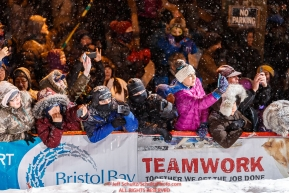The crowd is excited to see Pete Kaiser cross the Nome finish line to win the 2019 Iditarod Trail Sled Dog Race. Pete's winning time is 9 days 12 hours 39 minutes and 6 secondsPhoto by Jeff Schultz/  (C) 2019  ALL RIGHTS RESERVED
