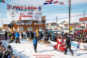 Mitch Seavey runs down the chute and crosses the finish line to win his third Iditarod in record time of 8 days, 3 hours, 40 minutes and 13 seconds in Nome during the 2017 Iditarod on Tuesday afternoon March 14, 2017.Photo by Jeff Schultz/SchultzPhoto.com  (C) 2017  ALL RIGHTS RESERVED