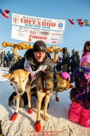 Dallas Seavey poses at the finish line in Nome with his lead dogs after finishing in 2nd place during the 2017 Iditarod on Tuesday eveing March 14, 2017.Photo by Jeff Schultz/SchultzPhoto.com  (C) 2017  ALL RIGHTS RESERVED