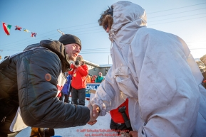 Second place finisher Dallas Seavey (left) congratulates 3rd place finisher Nicholas Petit at the finish line in Nome during the 2017 Iditarod on Tuesday eveing March 14, 2017.Photo by Jeff Schultz/SchultzPhoto.com  (C) 2017  ALL RIGHTS RESERVED