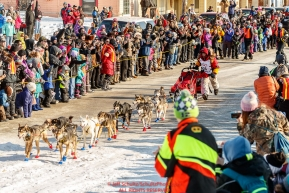 Mitch Seavey runs down Front street in Nome between the crowd to win his third Iditarod in record time of 8 days, 3 hours, 40 minutes and 13 seconds in Nome during the 2017 Iditarod on Tuesday afternoon March 14, 2017.Photo by Jeff Schultz/SchultzPhoto.com  (C) 2017  ALL RIGHTS RESERVED
