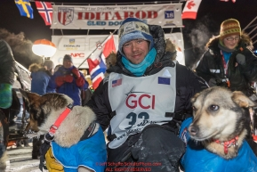 Joar Leifseth Ulsom congratulates his leaders at the finish line in Nome, Alaska early on Wednesday morning March 14th as he wins the 46th running of the 2018 Iditarod Sled Dog Race.  He finished in 9 days 12 hours 00 minutes and 00 secondsPhoto by Jeff Schultz/SchultzPhoto.com  (C) 2018  ALL RIGHTS RESERVED